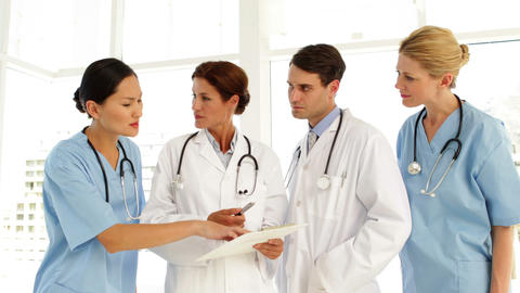 Medical team discussing a file Stock Video Footage