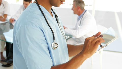 Male nurse going over a file Stock Video Footage