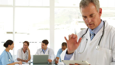Mature doctor using his tablet Stock Video Footage