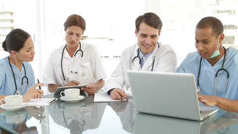 Medical team talking during a meeting Stock Video Footage