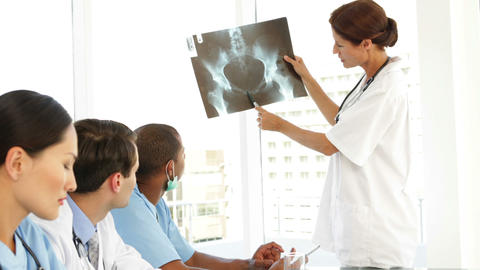 Medical team discussing an xray during meeting Footage