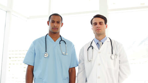 Serious surgeon and doctor Stock Video Footage
