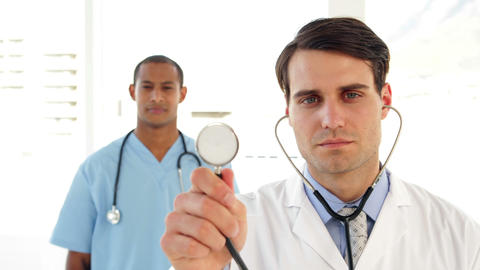 Doctor holding up his stethoscope Stock Video Footage