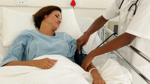 Smiling nurse in the ward talking to her patient Stock Video Footage