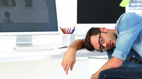 Photo editor sleeping at his desk Stock Video Footage