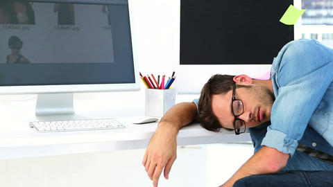 Photo editor sleeping at his desk Footage