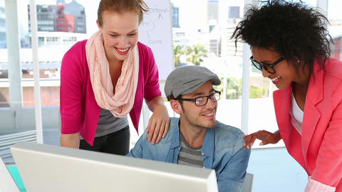 Creative team working together happily looking at screen Stock Video Footage