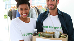 Happy volunteer team holding a food donation box Stock Video Footage