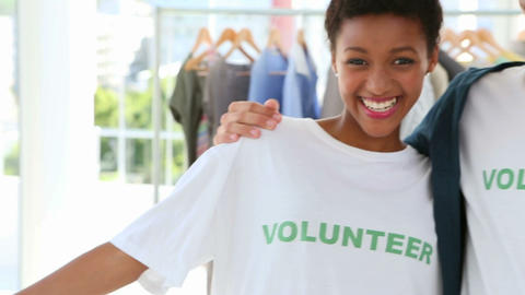 Happy volunteer team smiling at the camera Stock Video Footage