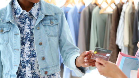 Woman paying for her purchases with credit card Stock Video Footage