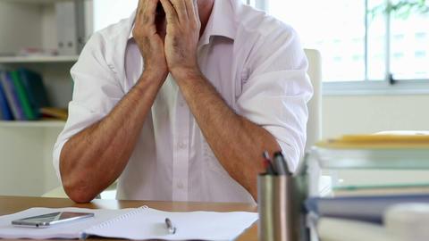 Businessman having a headache at his desk Stock Video Footage