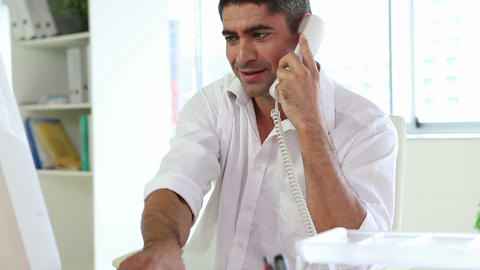 Businessman working and talking on the phone Footage