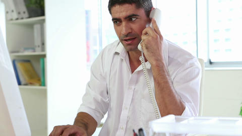 Businessman working and talking on the phone Stock Video Footage