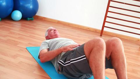 Senior man doing sit ups Footage