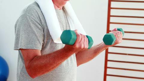 Senior man lifting hand weights Stock Video Footage