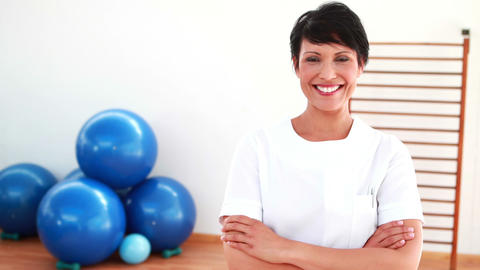 Pretty physiotherapist smiling at camera Stock Video Footage