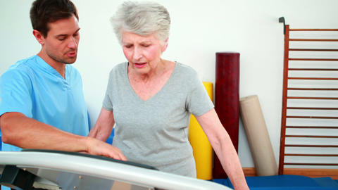 Physical therapist showing patient how to use exercise... Stock Video Footage