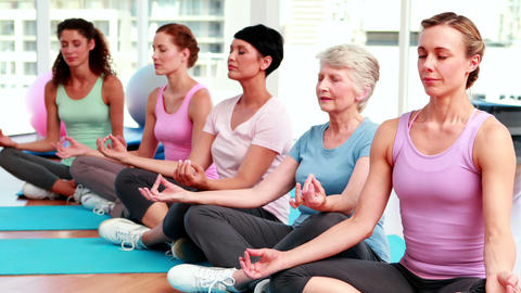 Group of women in fitness studio doing yoga Stock Video Footage