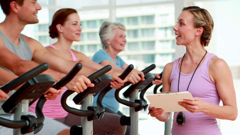 Happy group doing a spinning class Stock Video Footage