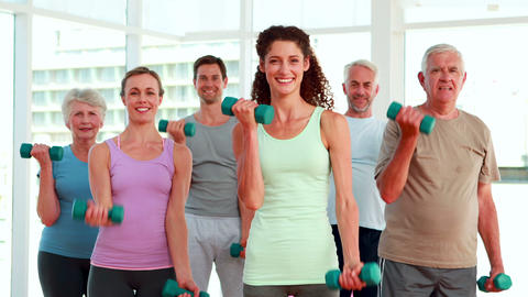 Fitness group lifting hand weights Stock Video Footage