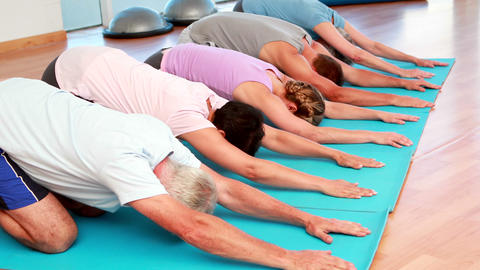 Yoga class in childs pose together Stock Video Footage