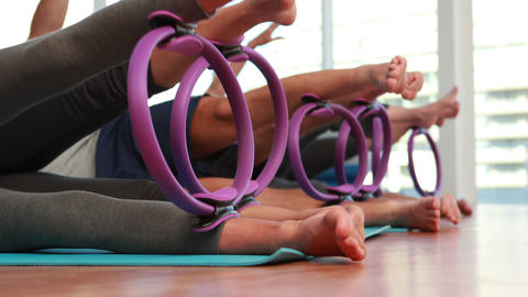 Pilates class using pilates rings Stock Video Footage