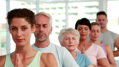 Yoga class standing with eyes closed Stock Video Footage