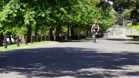 Woman on a bike ride in the park Footage