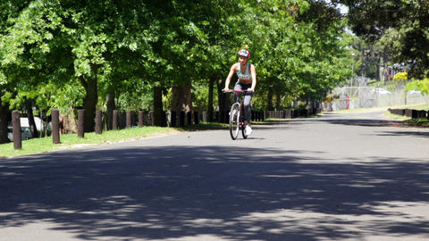 Woman on a bike ride in the park Stock Video Footage