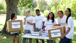 Group of young volunteers sorting donation boxes Stock Video Footage