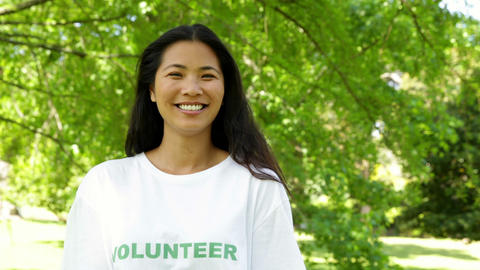 Pretty volunteer smiling at the camera Stock Video Footage