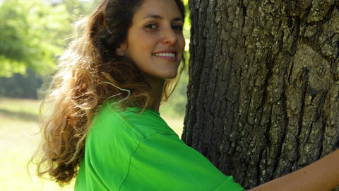 Environmental activist hugging a tree Stock Video Footage