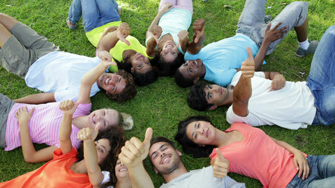 Group of casual young friends lying in a circle Stock Video Footage