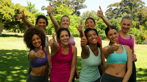 Fitness class giving thumbs up to camera Stock Video Footage