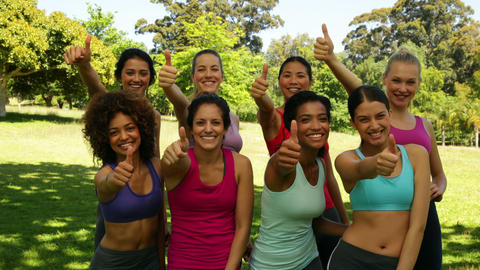 Fitness class giving thumbs up to camera Footage