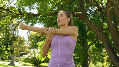 Runner stretching arms listening to music in the p Footage