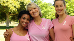 Smiling women wearing pink for breast cancer awareness in... Stock Video Footage