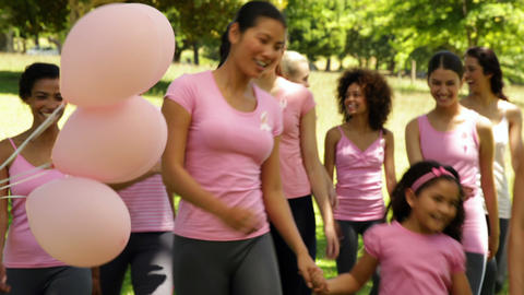 Happy women going on a walk for breast cancer awareness... Stock Video Footage