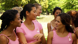 Happy women in pink for breast cancer awareness in the... Stock Video Footage