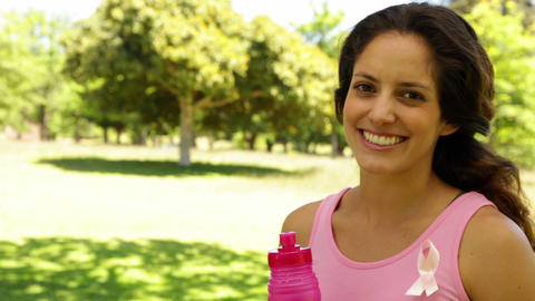 Happy woman wearing pink for breast cancer awareness... Stock Video Footage