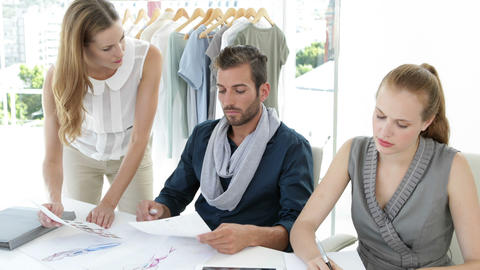 Fashion design team working together at table Stock Video Footage