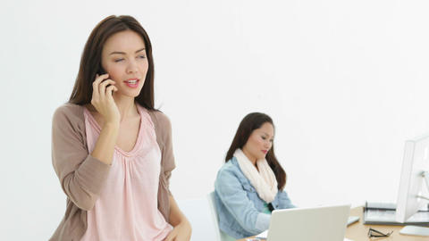 Creative businesswoman talking on phone with colleague... Stock Video Footage