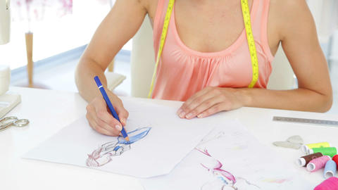 Attractive fashion designer sketching a design Stock Video Footage