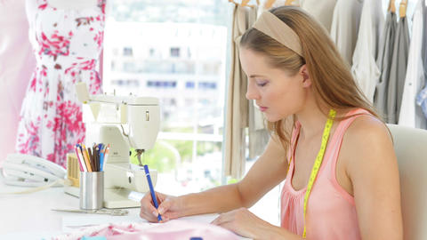 Attractive fashion designer sketching at table Stock Video Footage
