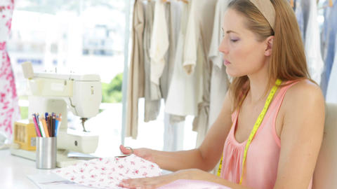 Attractive fashion designer cutting material Stock Video Footage