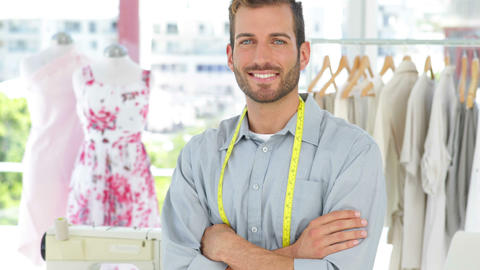 Handsome fashion designer smiling at camera with arms... Stock Video Footage
