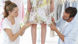 Fashion Designers Adjusting Hemline Of Dress On A  stock footage