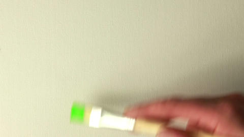 Hand painting green with paintbrush Footage