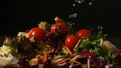 Water dropping onto fresh salad Footage
