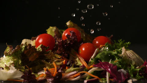 Water dropping onto fresh salad Stock Video Footage